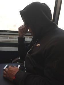 Wired millennial on Amtrak train