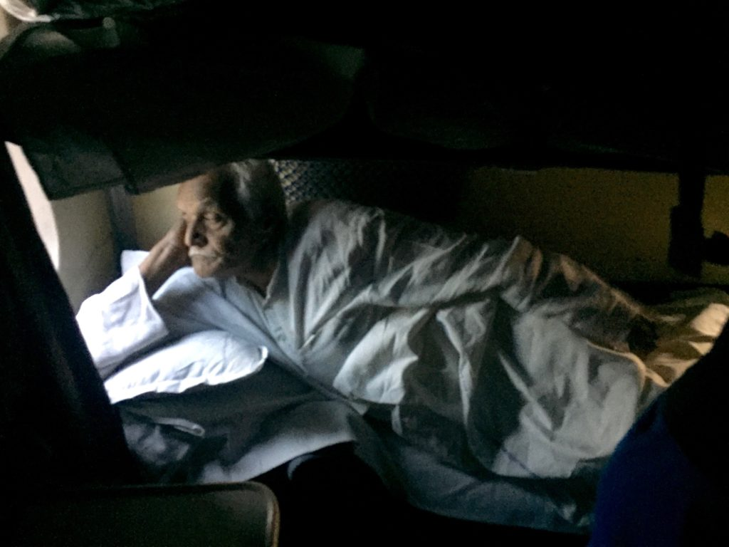 Passenger in sleeper car on train to Allahabad, India